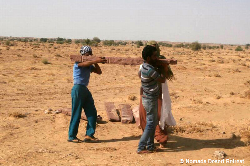 nomads-desert-retreat-carrying-stone